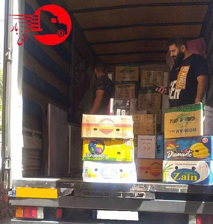 بارگیری اثاث در کامیون توسط پرسنل آنی بار